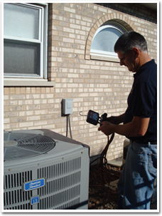 Technician proving residential air conditioning service in the Orland Park, IL, area